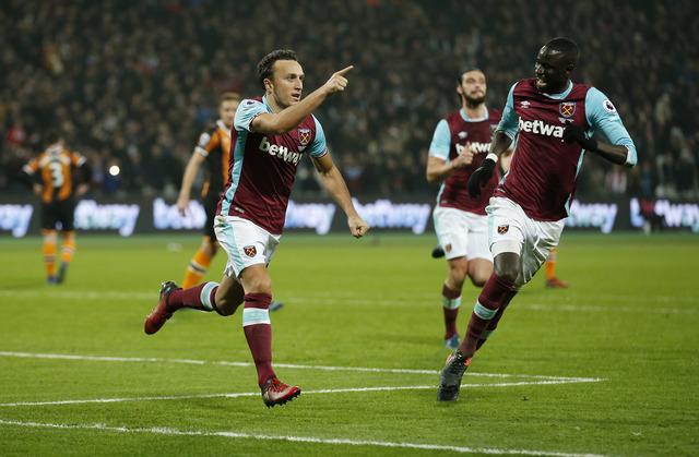 Pemain West Ham United merayakan gol. (Reuters / Matthew Childs)