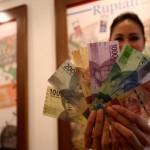 KURS RUPIAH : Mata Uang Safe Haven Kian Diminati, Rupiah Melemah Jadi Rp13.403/US$