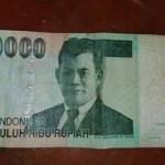 Ilustrasi uang kanibal (Twitter @achietmokoginta)