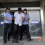 Wang saat ditangkap polisi Tiongkok (China Business News)