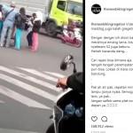 Pedagang es di tengah jalan karena lampu merah lama (Instagram)