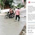 Bocah berseragam terjebak di coran beton yang masih basah (Instagram)