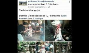 Hasil capture status pengguna akun Facebook Achmad Fuad Hamzah yang menunjukkan penyembelihan anjing. (Facebook.com-Meika Yuni L)