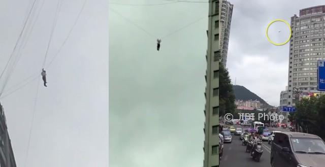 Seorang pria terjebak di kabel telepon di ketinggian 19 lantai (Shanghaiist)