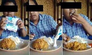 Pria yang livestreaming Facebook makan dengan ayam goreng dan sabun colek. (Istimewa/Facebook)