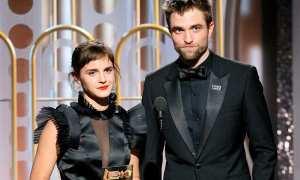 Penampilan Emma Watson dan Robert Pattinson dalam acara Golden Globes 2018, Minggu (7/1/2018). (People)