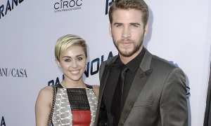 Miley Cyrus dan Liam Hemsworth (Billboard)