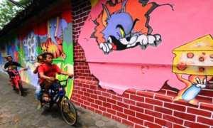Sejumlah bocah bersepeda di gang Kampung Pelangi Rekesan, Sidorejo, Salatiga, Jateng, Kamis (28/12/2017). (JIBI/Solopos/Antara/Aloysius Jarot Nugroho)