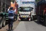 BISNIS LOGISTIK : Pungutan Jalanan Beratkan Pengusaha Angkutan Darat