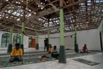 FOTO DAMPAK LETUSAN KELUD : Tempat Ibadah Pasca Letusan Kelud