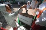 FOTO PEMILIHAN POLISI ANAK : Memasukkan surat suara