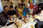 FOTO BISNIS.COM : Redaksi Bisnis.com Rayakan Tampilan Baru