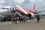 Ilustrasi maskapai AirAsia Indonesia (Ibda Fikrina Abda/JIBI/Solopos)
