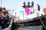 FOTO PAKAIAN IMPOR : Penyelundupan Pakaian Bekas Diadang