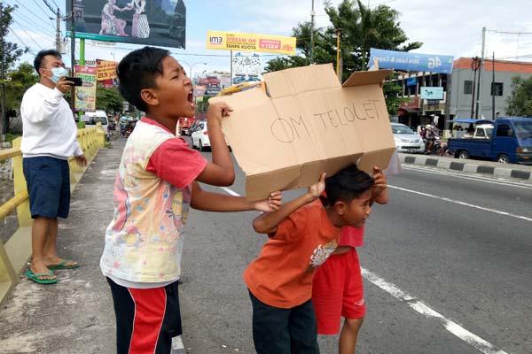 DEMAM TELOLET : Keceriaan Anak-Anak Mengisi Liburan Sekolah dengan Berburu Telolet