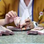 Ilustrasi menghitung rupiah. (Rachman/JIBI/Bisnis)