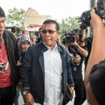 Anggota Komisi III DPR Masinton Pasaribu berjalan menuju Gedung KPK, Jakarta, Selasa (15/8/2017). (JIBI/Solopos/Antara/M Agung Rajasa)