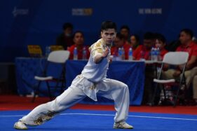 Atlet wushu putra Indonesia Edgar Xavier mengikuti final wushu taolu changquan putra SEA Games 2019 di World Trade Center, Manila, Filipina, Minggu (1/12/2019). (Antara/Sigid Kurniawan)