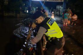 Tersumbat Sampah, Air Sungai Meluap Rendam Permukiman di Pasuruan