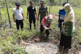 Tim gabungan menyelidiki kasus pembunuhan di perkebunan Dusun Pudak RT 003/RW 005, Kelurahan Wuryantoro, Kecamatan Wuryantoro, Wonogiri, Sabtu (22/2/2020). (Istimewa)