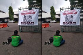 Ahmad Zainuddin menggelar demo tapa pepe sebagai bentuk penolakan Omnibus Law dan desakan pemerintah serius menangan Covid-19 di depan Kantor DPRD Jateng, Kota Semarang, Senin (30/3/2020). (Semarangpos.com-DPD FSPKEP KSPI Jateng)