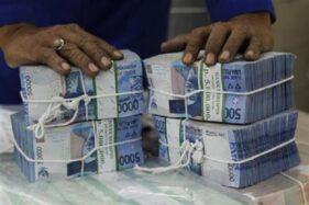 Ilustrasi uang. (Reuters/Supri)