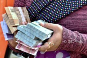 Ilustrasi uang (Antara-R. Rekotomo)