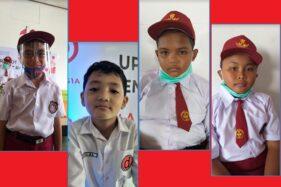 Lius, Hilal, Adit, dan Eko (dari kiri ke kanan) pembuat robot upacara di LKP Autobotschool, Klaten, Jawa Tengah. (Solopos.com/Ponco Suseno)