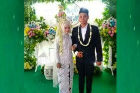 Ponari (kanan) dan istrinya. (Twitter)