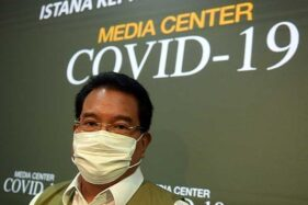 Juru Bicara Satgas Covid-19 Wiku Adisasmito berpose seusai memberikan keterangan di Kantor Presiden, Jakarta, Selasa (21/7/2020). (Antara-Akbar Nugroho Gumay)