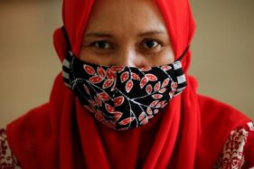 Ilustrasi penggunaan masker. (Reuters)