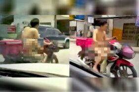 Pria yang mengendarai sepeda motor tanpa busana di Kanchanavich, Mueang Songkhla, Songkhla, Thailand pada Senin (21/9/2020). (Asia One)