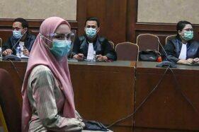 Terdakwa kasus suap pengurusan pengajuan fatwa Mahkamah Agung (MA) untuk membebaskan Djoko Tjandra, Pinangki Sirna Malasari, mengikuti sidang perdana di Pengadilan Negeri Jakarta Pusat, Rabu (23/9/2020). (Antara-Muhammad Adimaja)
