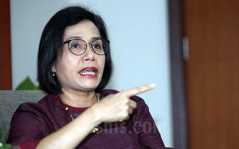 Menteri Keuangan Sri Mulyani Indrawati memberikan saat wawancara eksklusif dengan Jaringan Informasi Bisnis Indonesia (JIBI) di Jakarta, Jumat (22/11/2019). (Bisnis-Abdullah Azzam