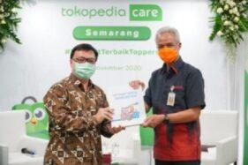 Gubernur Jateng, Ganjar Pranowo, bersama Co-Founder Tokopedia, Leontinus Alpha Edison, meresmikan Tokopedia Care di Kota Semarang, Selasa (24/11/2020). (Semarangpos.com-Imam Yuda S.)