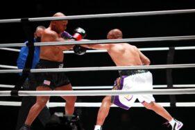 Meski Badan Kesakitan, Jones Ketagihan Lawan Mike Tyson