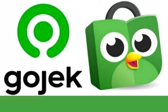 Ilustrasi merger Gojek dan Tokopedia. (Solopos.com-Dok.)