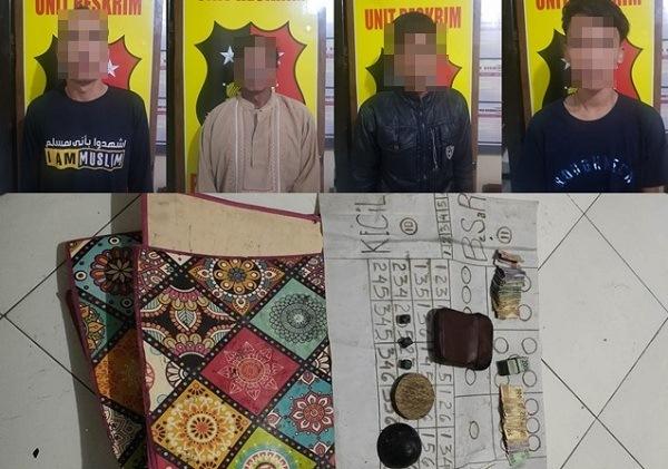 Empat pelaku dan barang bukti perjudian dadu kopyok. (Madiunpos.com-Polsek Mlarak)